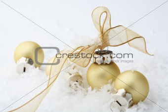 Gold Christmas bauble decorations with ribbon.