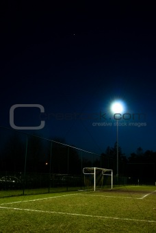 football field lit at night