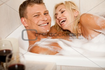 Affectionate couple bathing