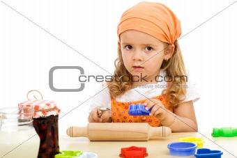 Little girl preparing to make cookies