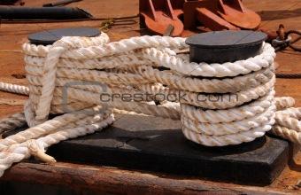 Old ropes tying ship