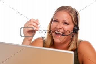 Attractive businesswoman Laughs as she talks on her phone headset.