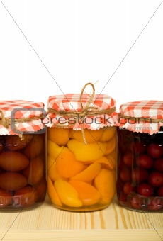 Canned fruits on the shelf - isolated
