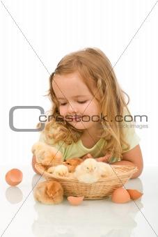 Little girl observing her little chicken babies