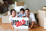 Happy family lying on the floor after buying house