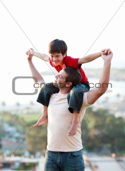 Father giving his son piggyback