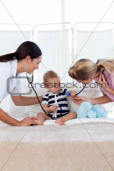 Baby with pediatrician and nurse