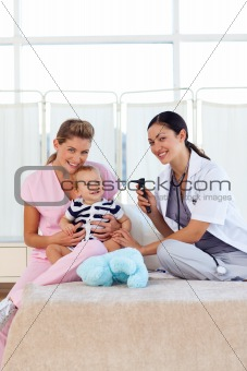 Baby with pediatrician and nurse with copy-space