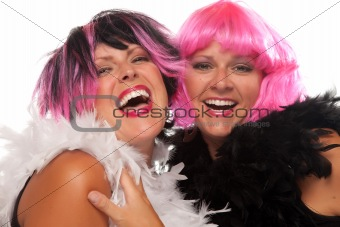 Portrait of Two Pink And Black Haired Smiling Girls with Boas Isolated on a White Background.