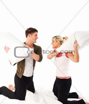 Boyfriend ang girlfriend having a pillow fight