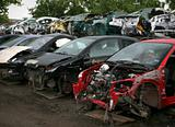 Car cementary with many broken cars