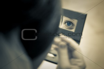 woman eye captured in the mirror