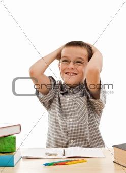 Happy schoolboy doing his homework