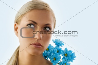 blond girl and blue daisy