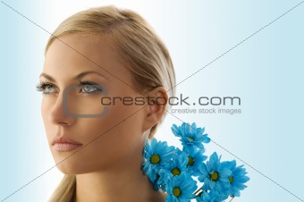 blond girl with blue daisy