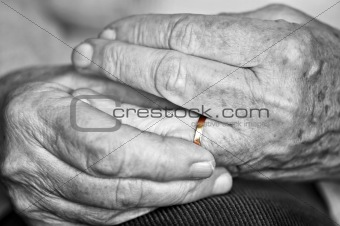 Old hands with wedding band