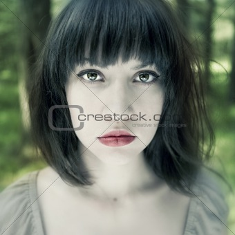Young fine woman in forest