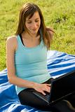Woman with laptop working outdoor