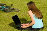 Student with laptop outdoor
