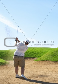 Golfer in the sand bunker