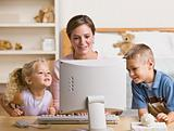 Woman and Children Playing on Computer