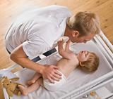 Man Changing Baby