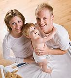 Couple with Baby on Changing Table