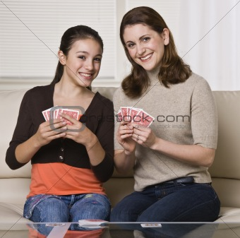 Mother and Daughter Playing Cards