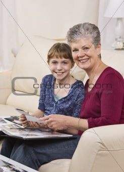 Grandmother and Granddaugter looking through album