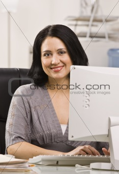 Attractive woman at desk.