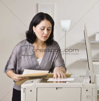 Attractive asian woman making copy.