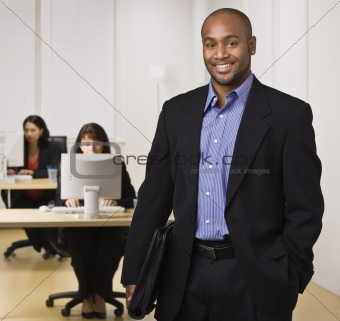 Man in Office Smiling at Camera