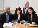 Four business workers smiling