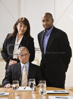 Three business people posing.