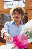 man buying flowers