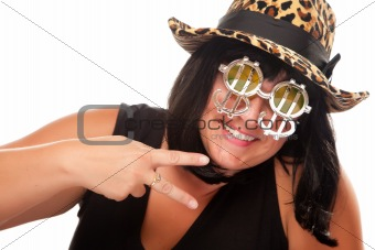 Beautiful Smiling Girl with Peace Sign, Bling-Bling Dollar Glasses and Funky Hat Isolated on a White Background.