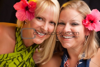 Beautiful Smiling Girls with Hibiscus Flowers in Their Hair.
