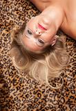 Beautiful Blonde Model Poses on Leopard Blanket.