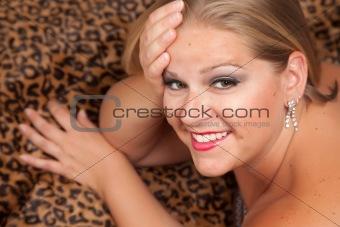 Beautiful Blonde Model Poses on Leopard Blanket.