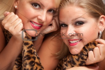 Beautiful Blonde Models Posing on Leopard Print Blanket.