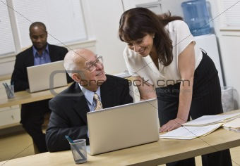 Attractive woman helping older man.
