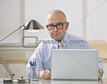 Older man on laptop.