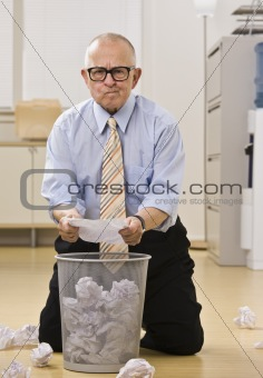 Attractive male senior searching the garbage.
