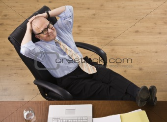 Attractive senior business man relaxing.