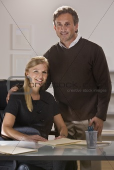 Attractive couple at office.