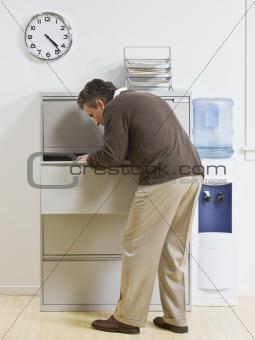 Man Looking Through Drawer