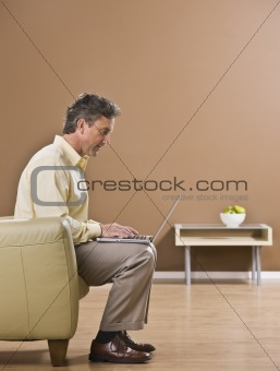 Attractive Business Man Using Laptop