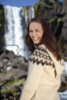Beautiful Scandinavian Woman By A Waterfall