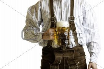 Bavarian man hold beer stein at Oktoberfest