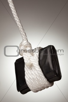 Tied Up and Hanging Wallet on a Spot Lit Background.